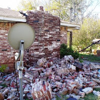 This home in Prague, Okla., was damaged from a magnitude 5.6 earthquake in 2011. Scientists have concluded it was likely caused by the injection of wastewater from oil and gas wells. (Credit: Brian Sherrod, USGS) Click to Enlarge.