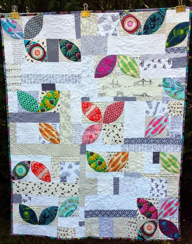 http://quiltyhabit.blogspot.com/2014/07/scatter-finished-orange-peel-quilt.html