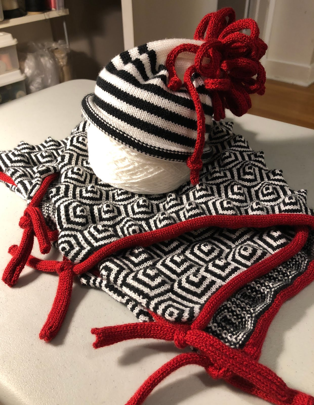 Then I decided I needed to make a little hat to coordinate with the  blankie. It is the first project made on a new (to me) machine f03eb0734523