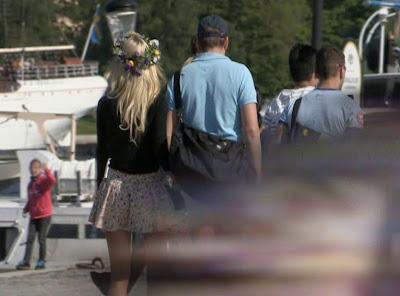 attractive blonde girl in dress walking with boyfriend
