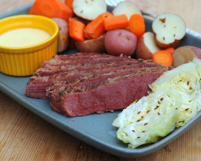 Caraway Corned Beef, the St. Patrick's Day favorite, the whole meal, meat, carrots, potatoes and cabbage with a drizzle of cheese sauce for good measure | Weight Watchers PointsPlus 8 | Kitchen Parade