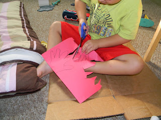 Cut out handprint to use as turkey feathers