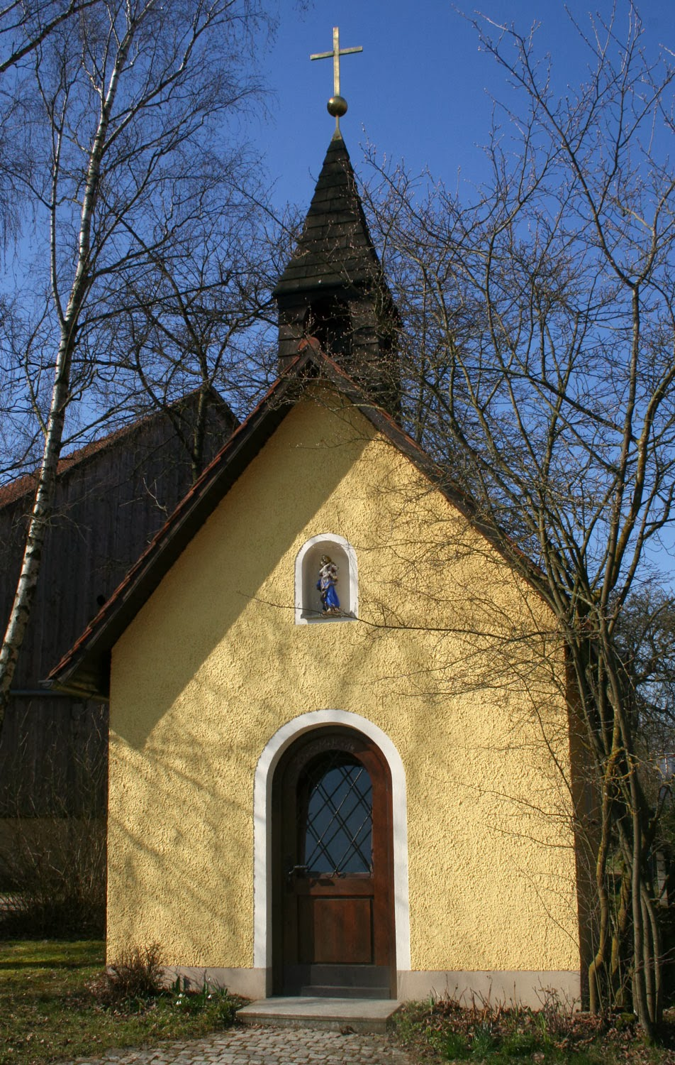 A tiny chapel by the side of the road