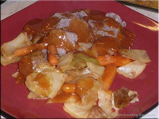 pot roast with roasted tomato gravy plated