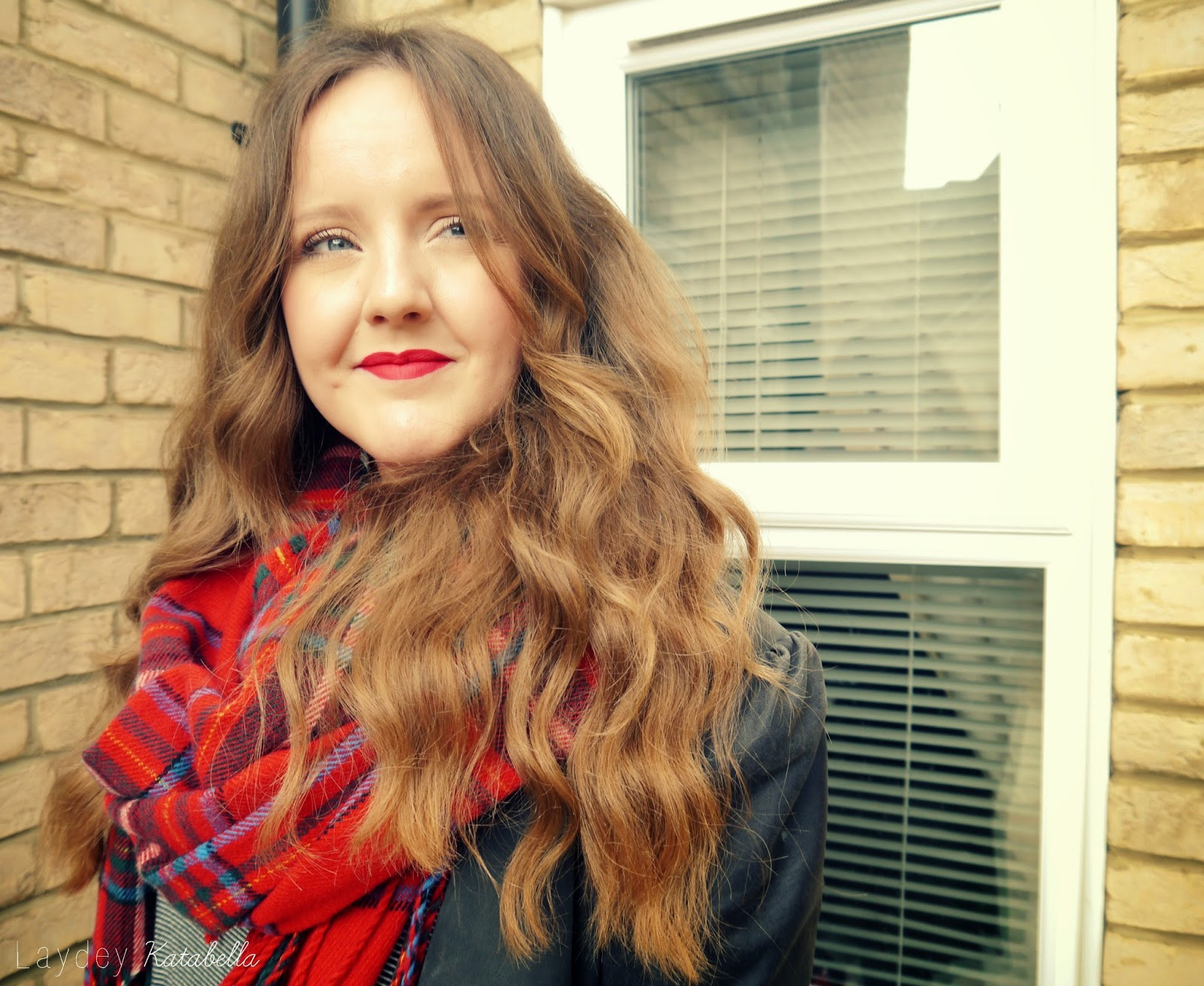 red lip and tartan