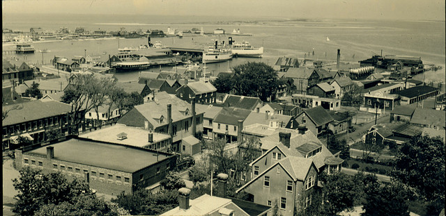 Tower view of downtown Nantucket, 1930s, showing Main Street, the Skipper Restaurant, and Brant Point. Source: Nantucket Historical Association