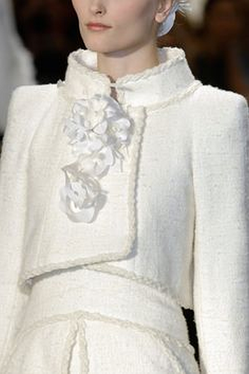 Chanel runway details: pure white tweed suit