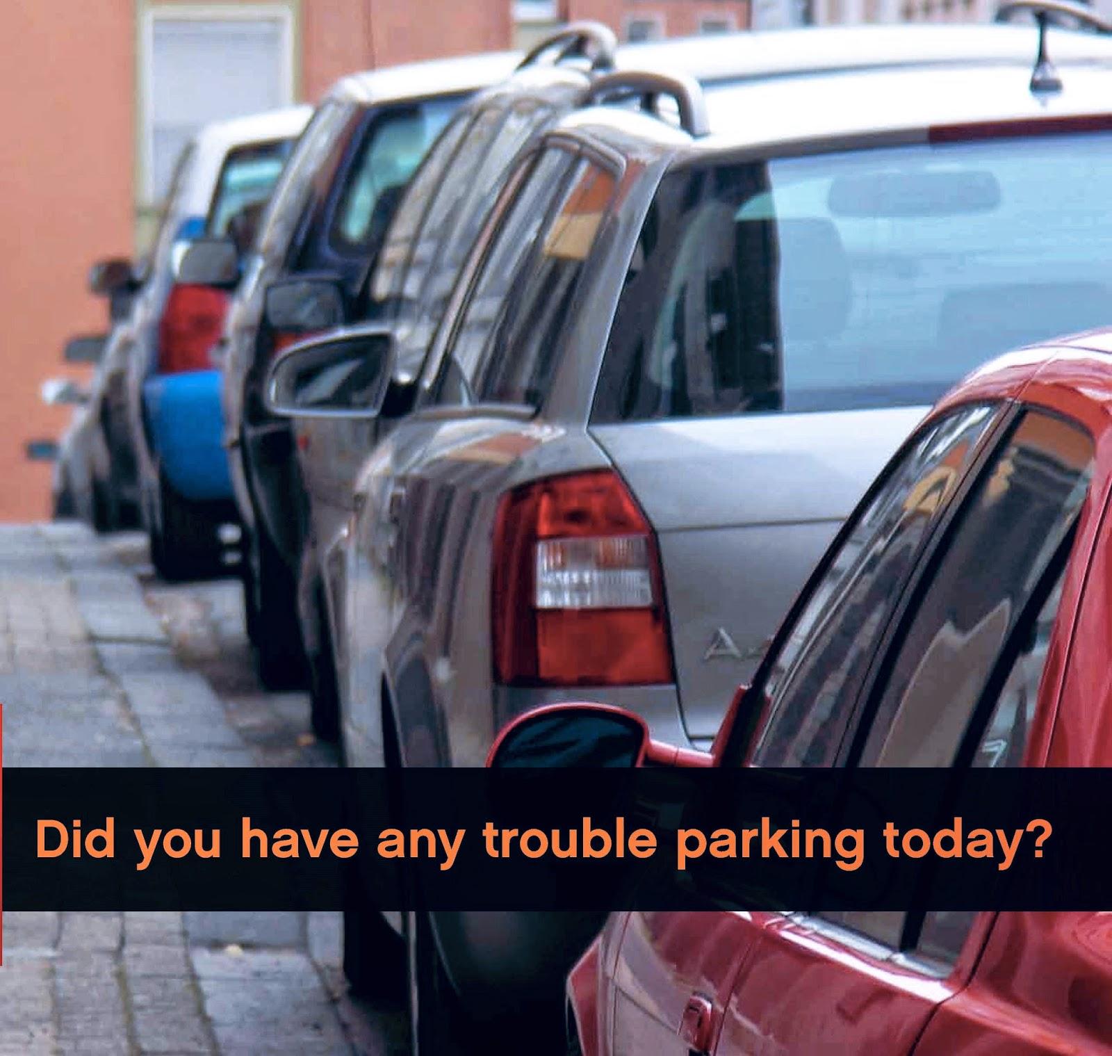 foto de una fila de coches aparcados en la calle