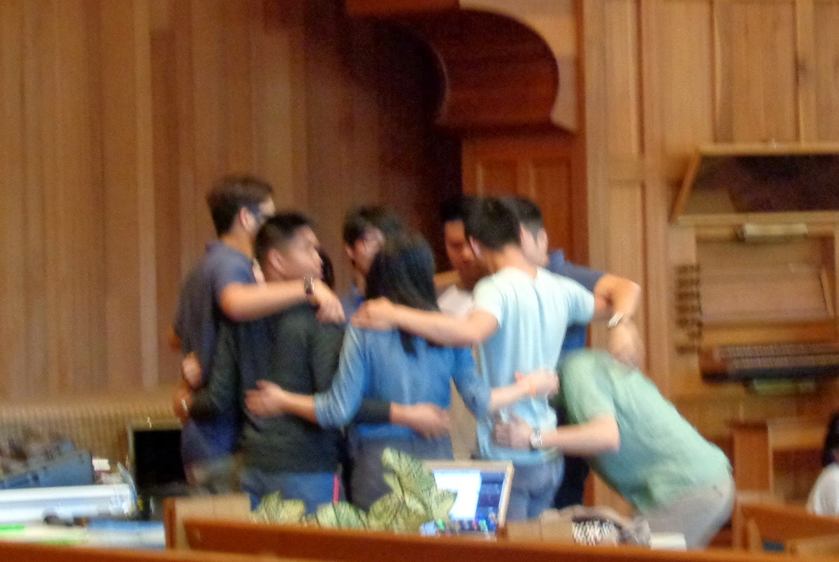 worship team praying together before service
