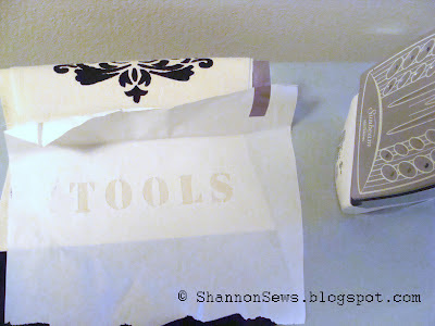 Place the freezer paper stencil's waxy side face down on the fabric and iron on