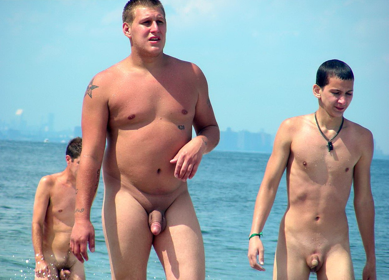 naked boys play on beach