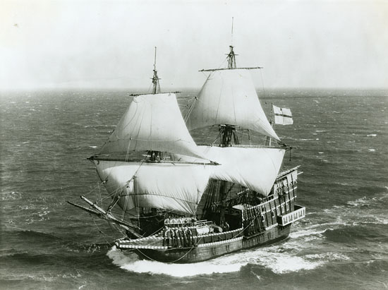 Black-and-white photographic print mounted on paper, 8 x 10 inches. The vessel is underway with full sail. Norgaard designed and oversaw the construction of this replica of the original GOLDEN HINDE, from 1971-1973.