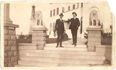 William S Bean of Alameda California standing with another man near steps and pillars with lion statues