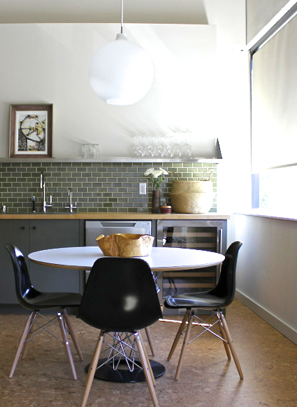 Breakfast Nook with round table and black Eames chairs in a home designed by Krista Schrock and David John Dick