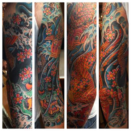 Ocean sleeve tattoo with octopus and fish by tattoo artist Jason Kunz for Triumph Tattoo