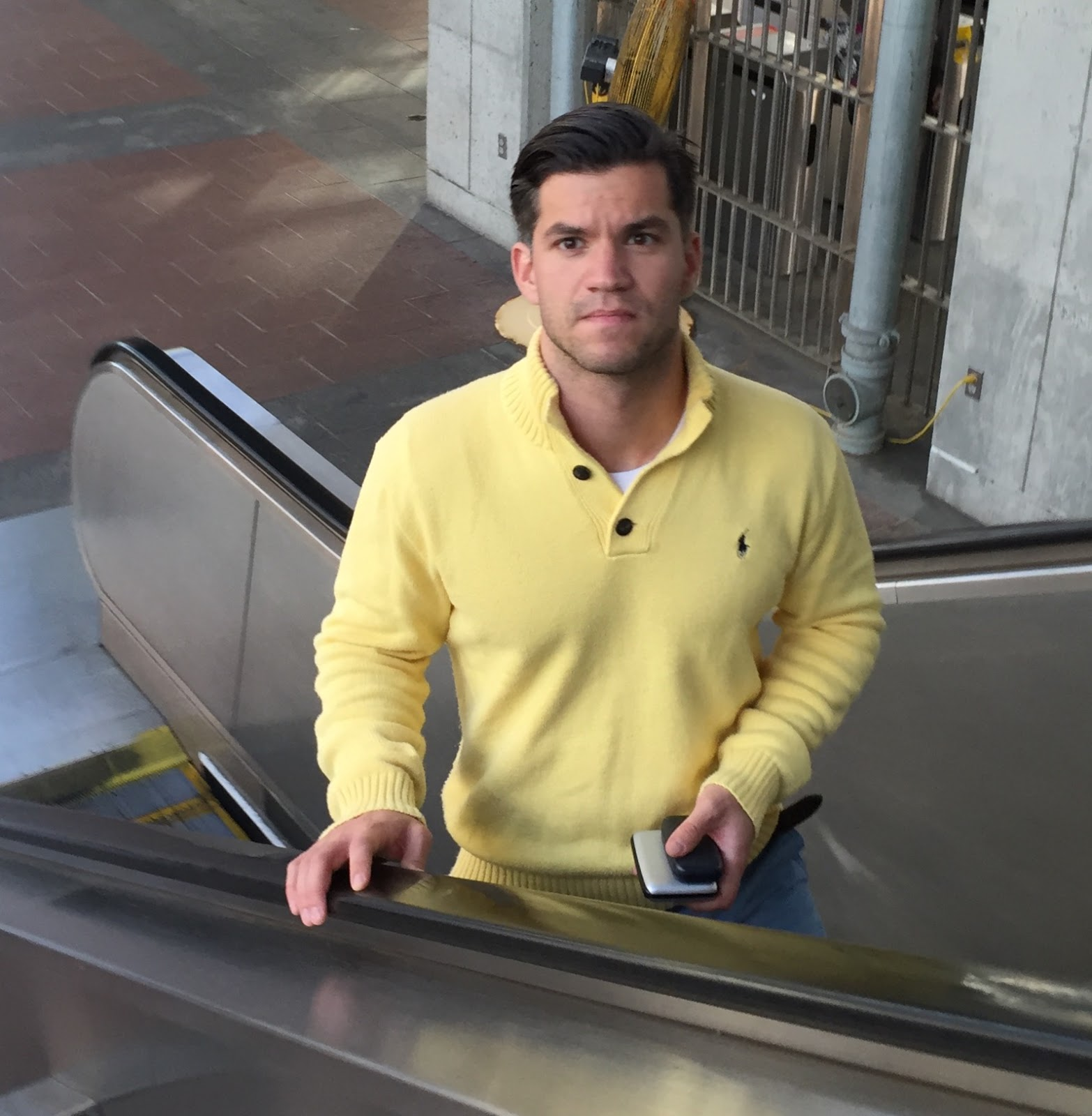 Men In Lemon Yellow Always Standout And This Standout Hottie Ascending A T Escalator Looks Ever So Delicious In His Creamy Lemon Pullover Polo Sweater