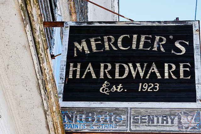 old paint peeling Mercier's Hardware sign