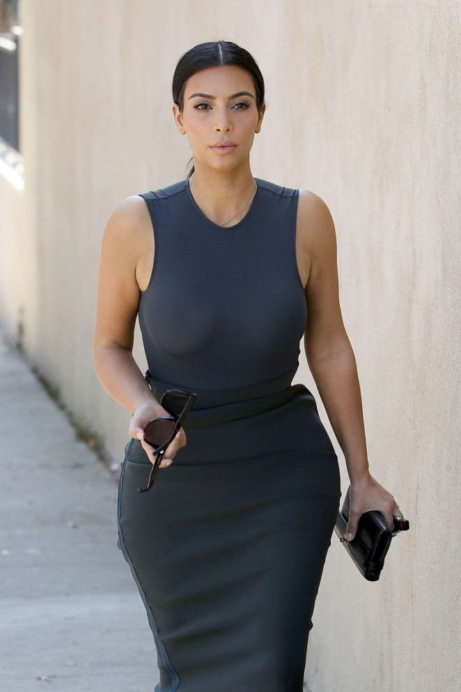 Kim Kardashian goes braless in a clingy dress in LA