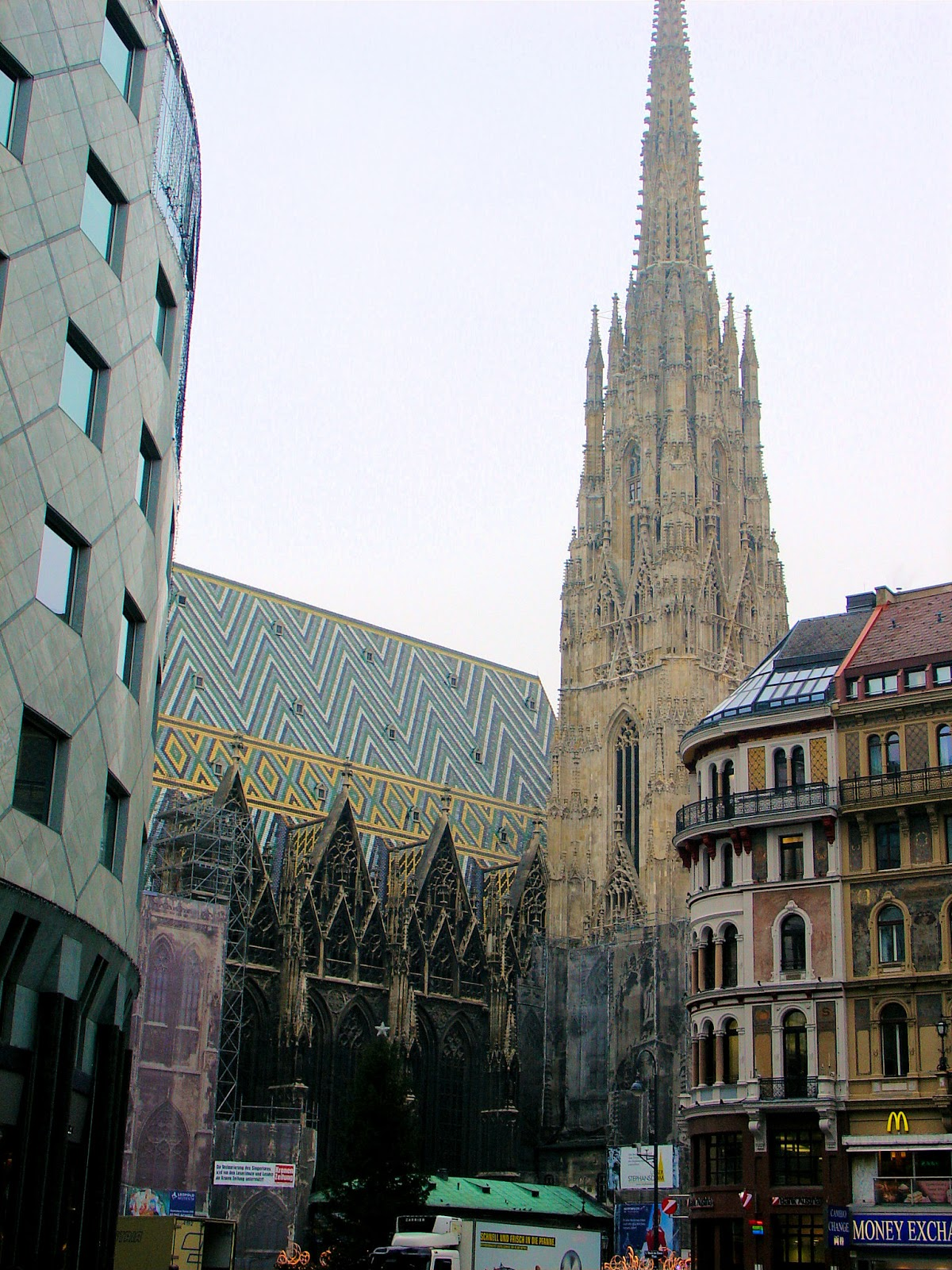 The Haas Haus at the left has become a controversy in the city of Vienna due to its modern architectural style juxtaposed with Saint Stephan's in the background. Look deeper, and more contrast in the geometric patterns on the roof.