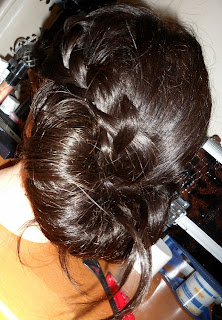Updo hairstyling with braid chignon, great for weddings and Brides