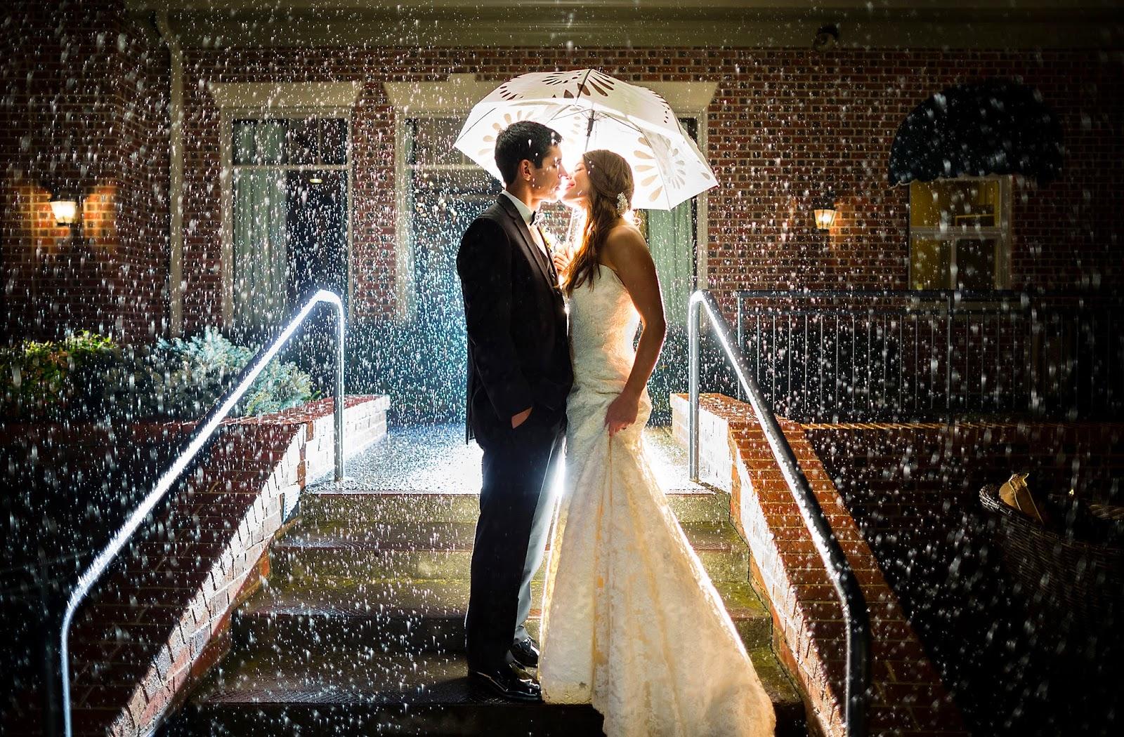 wedding photographers umbrella wedding rain