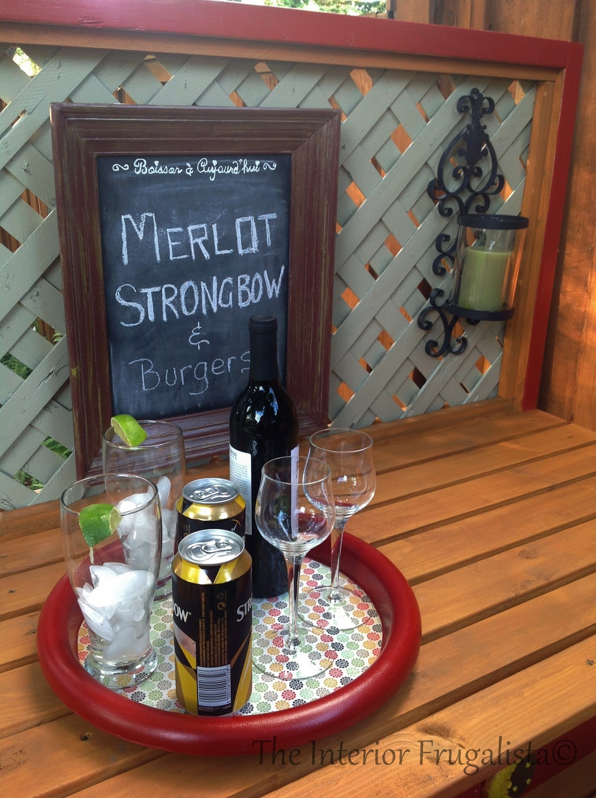 Easy DIY potting bench and outdoor bar with candle sconces and menu board
