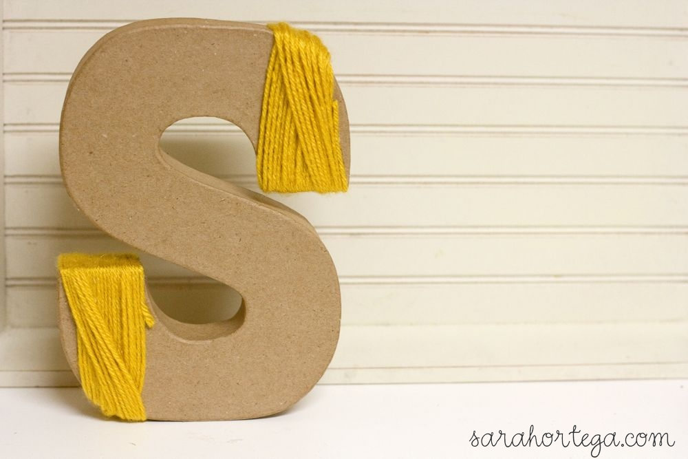 wooden letters covered in yarn