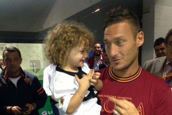 Roma captain Francesco Totti is seen chatting with Chanel Bocconi after their game against Parma