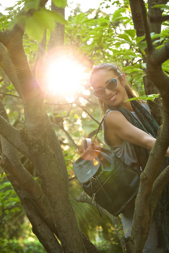 occhiali da sole con piume