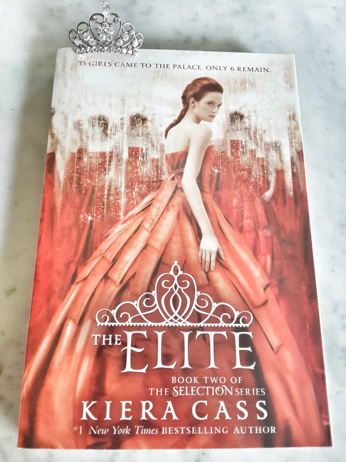 the elite by kiera cass the Kiera cass's the elite is a must-read for fans of dystopian fiction, fairy tales, and reality tv this sequel to the selection will enchant teens who love divergent and the bachelor in america singer's world, a bride is chosen for the prince through an elaborate televised competition in the second book of the selection series, america is one of.