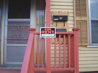 """FOR RENT"" sign in front of scattered-site rental"