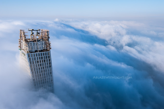 Photo of Infinity tower's top floors above the fog