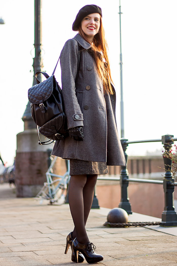 Fashion blogger outfit with quilted backpack, seam tights and tweed pencil skirt
