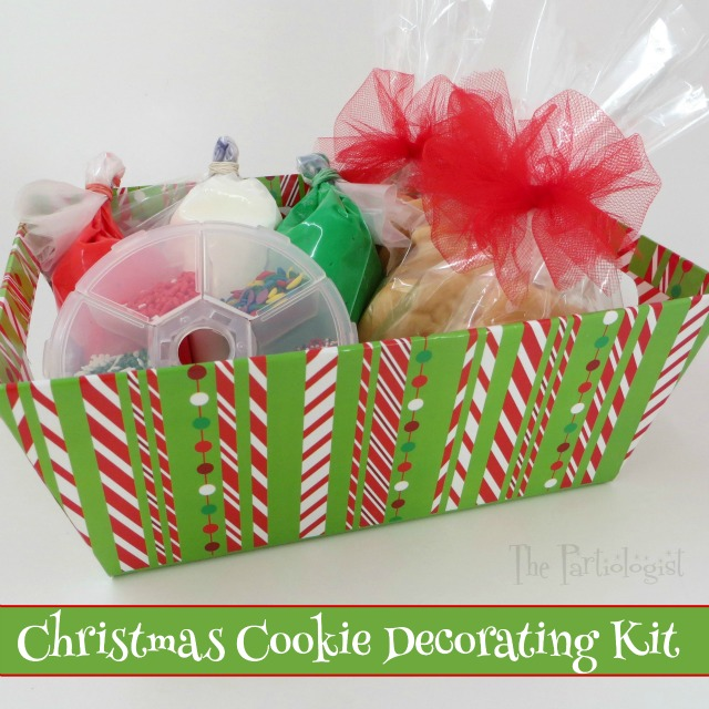 christmas cookie decorating kit all the goodies in one basket you can completely wrap the box with a cellophane bag tie with tulle and add a party pick