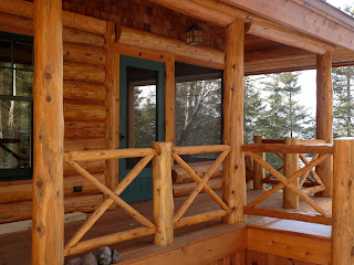 solid cedar screen door, green, built by john huisman, screen porch, log railing