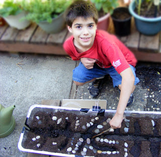 Organic Gardening Education with Kids - The process of forming irrigation canals.