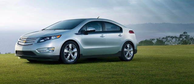 Front 3/4 view of silver 2012 Chevrolet Volt parked on a bluff overlooking the sea