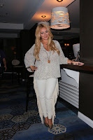 Aubrey O'Day standing by the bar