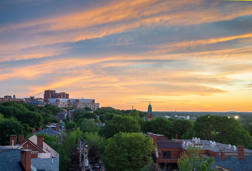 Portland, Maine USA June 2015 Summer Sunset over Parkside Neighborhood and Cumberland Avenue towards Maine Medical Center. Photo by Corey Templeton.