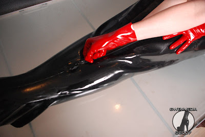 Hot Babe in Heavy Rubber Bondage Bag
