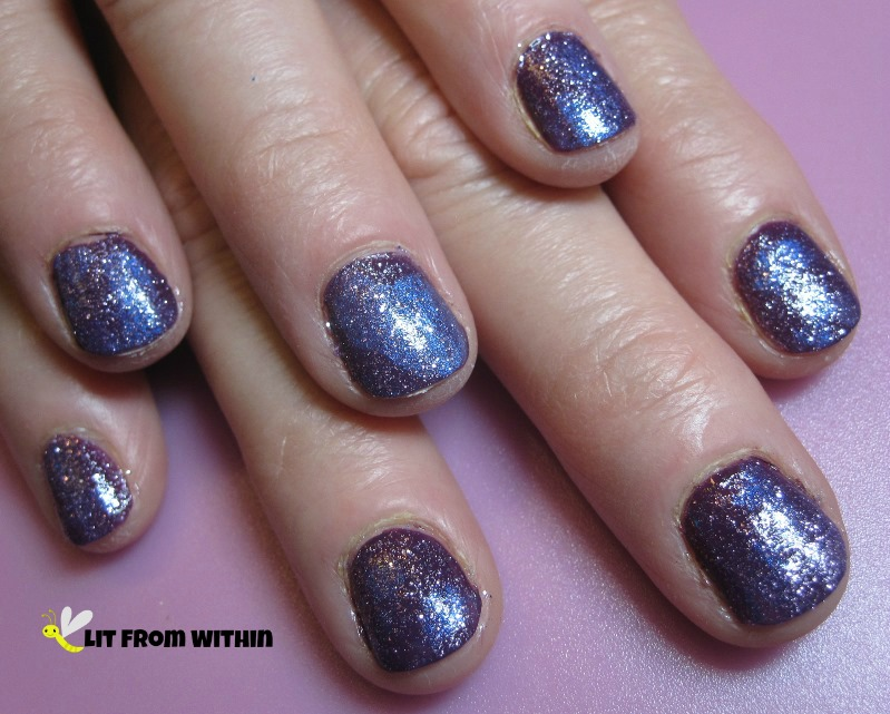 Sally Hansen Salon Trouble Maker, a soft blue-toned violet, dabbed with some L'Oreal The Shift Me, a pink iridescent color-changing topcoat, and POP Beauty purple glitter over everything