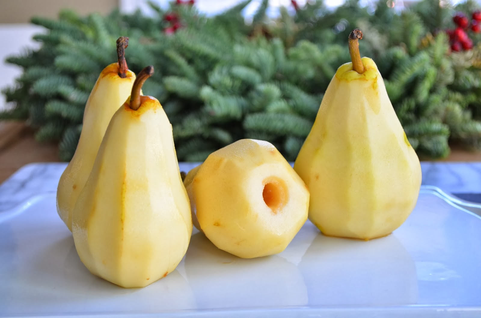 Poached pears with creme Anglaise, peeled pears