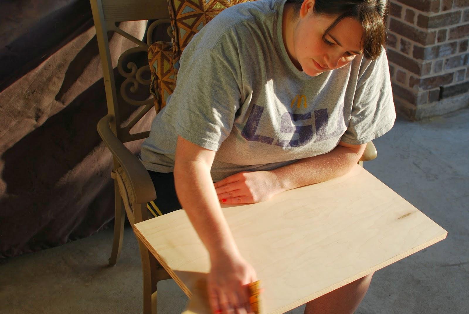 girl sanding maple wood