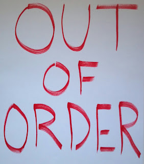 out of order sign in red ink