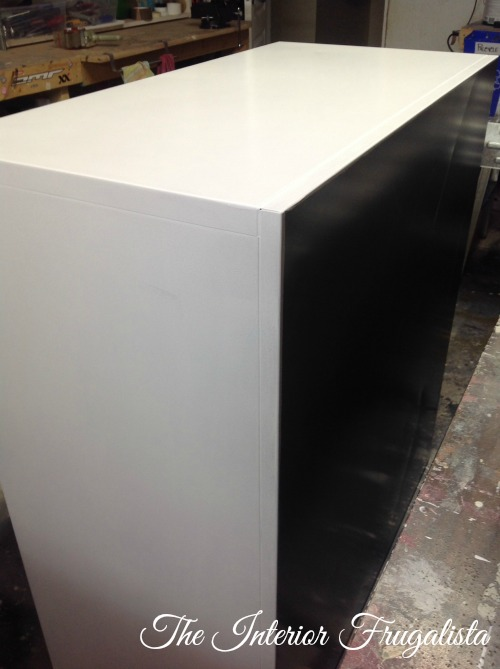 Metal File Cabinet After Rolled with White Latex Paint