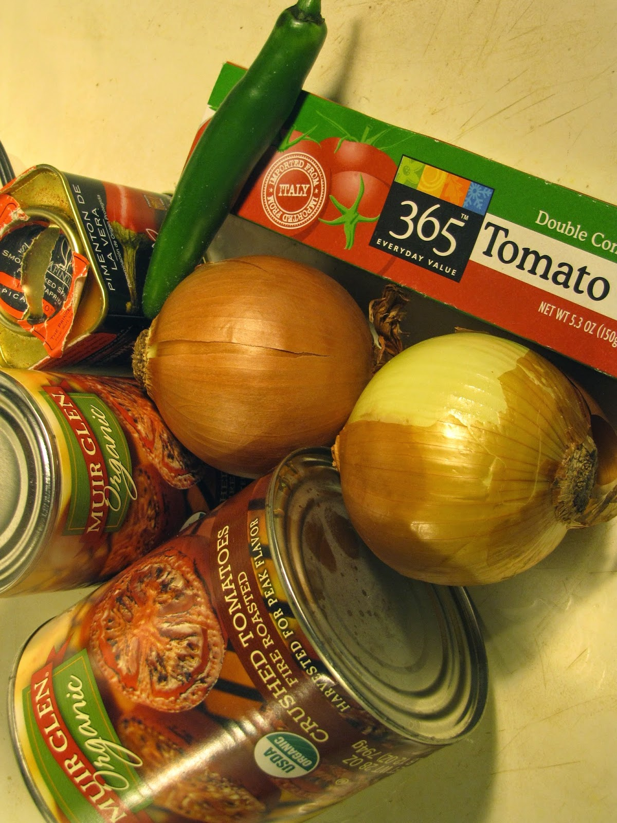 Canned tomatoes, 2 onions, jalapeno and spices for tomato sauce.