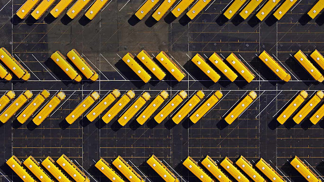 Yellow school buses parked in a lot (© Space Images/Blend Images/Getty Images) 638