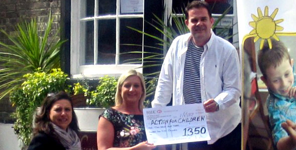 Valerie & Simon Lazenby, owners of Lazenby's  presenting the cheque to Briley Mundy, Senior Business Support Officer for May   Lodge, Action for Children.