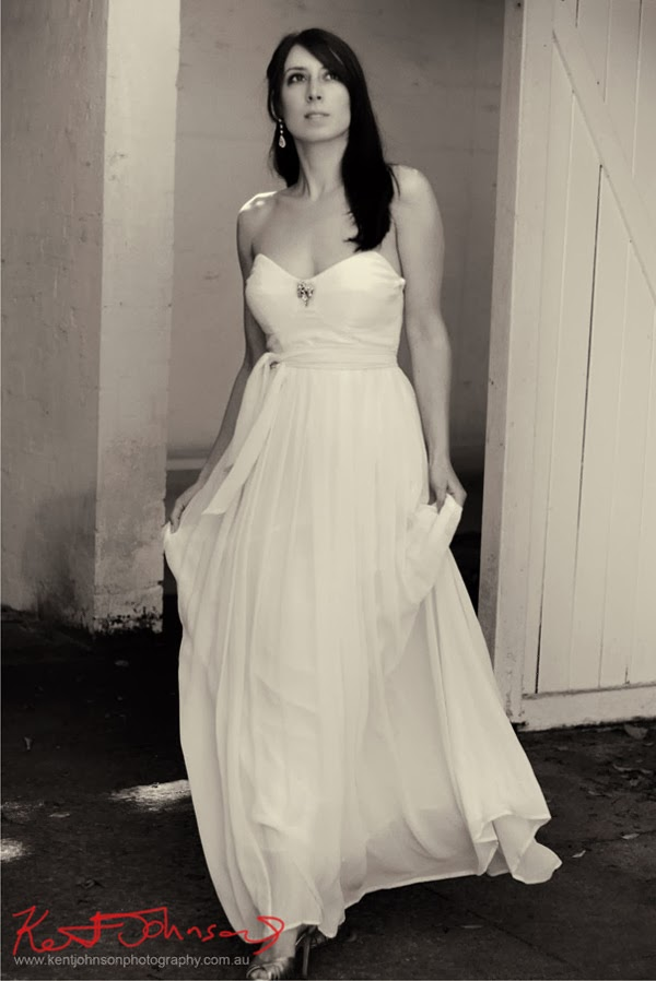 Flowing white bridal gown photographed in black and white on location by Kent Johnson.