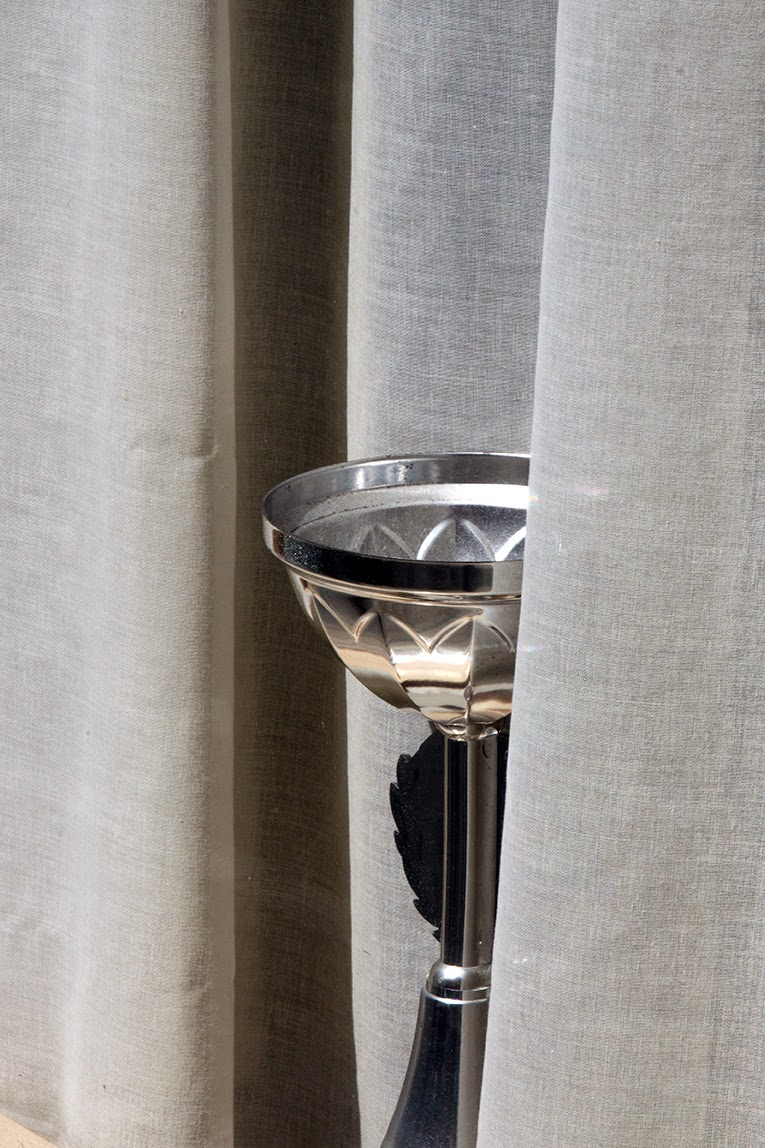 silver cup in window